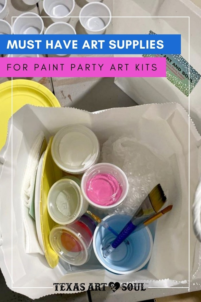 white gift bag with art supplies - paint, brushes, and cups